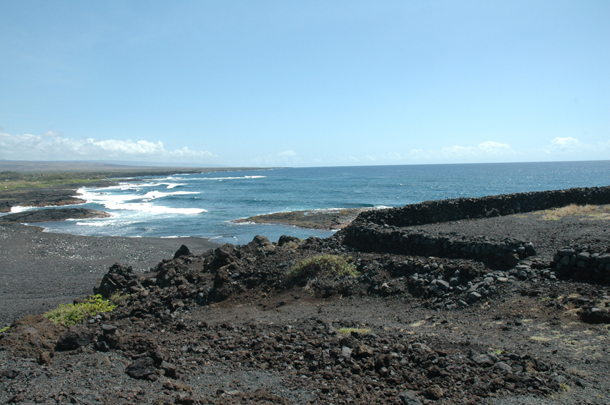 Nīnole looking towards Punalu'u.  The homesite and birthplace of  'Ōpūkaha'ia is located several coves north of this black sand beach.